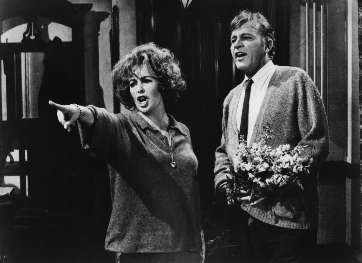 "CIRCA 1966: Elizabeth Taylor angrily points as Richard Burton looks on in a scene from the Warner Bros movie ""Who's Afraid of Virginia Woolf ?"" circa 1966. (Photo by Hulton Archive/Getty Images)"